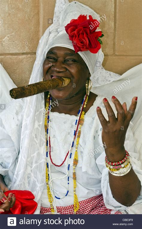 white santeria cuban wearing a santeria white dress a big