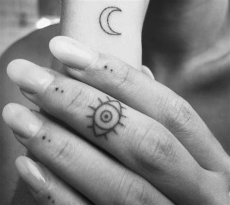 small eye tattoo on hand eyela tumblr com small minimal finger tattoos sun crest