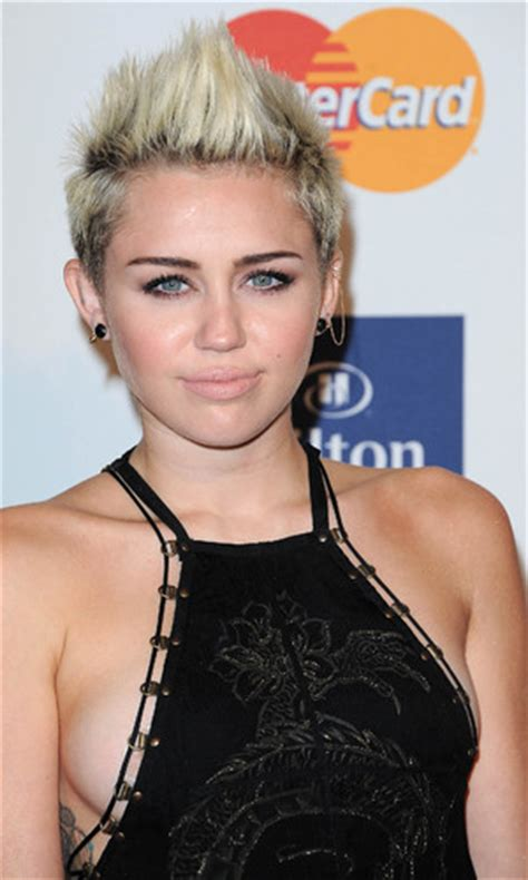 miley cyrus nearly makes a in black dress at pre