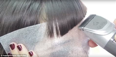 woman cuts hair with fork and clippers hair dressers are slicing off women s hair using men s