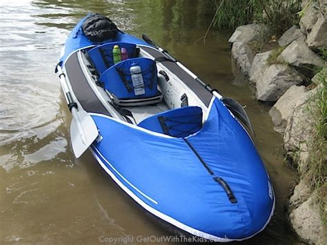 kayak surfing between two boats sevylor hudson inflatable kayak great for families