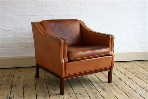tan leather armchair guiden prop hire