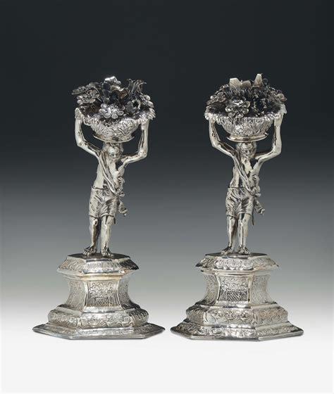 figure di fiori figure virili con cesti di fiori argento sbalzato
