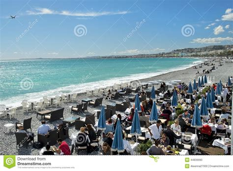 Waterfront House Designs vacationers sitting in cafe on beach french riviera nice