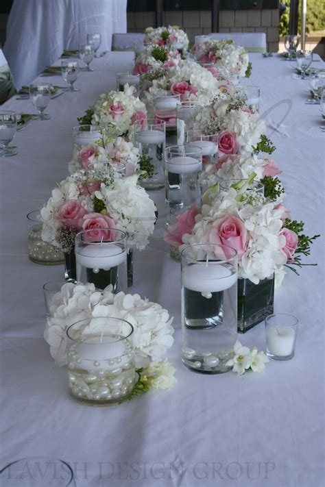 wedding centerpieces with candles and pearls classic floral arrangements for an intimate outdoor