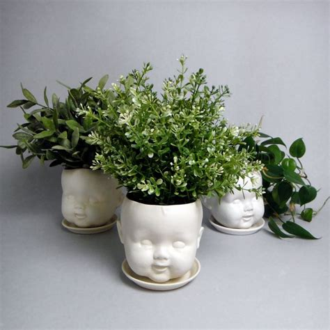 porcelain baby doll planter or dish