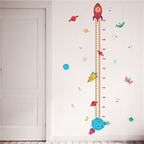 the best height for hanging art with infographic diy outer space planet pilot rocket growth chart home