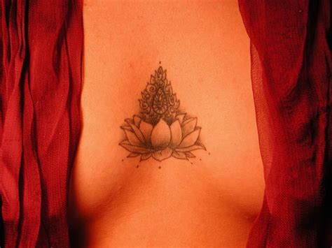 lotus tattoo under chest lotus blossom tattoo by shedonist dpchallenge