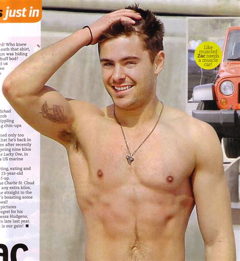 zac efron feather tattoo design biceps images designs