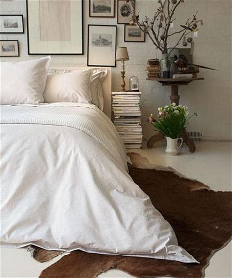 cowhide rug bedroom cow hide rug white bed perfection home ikea bed farmhouse bedrooms and