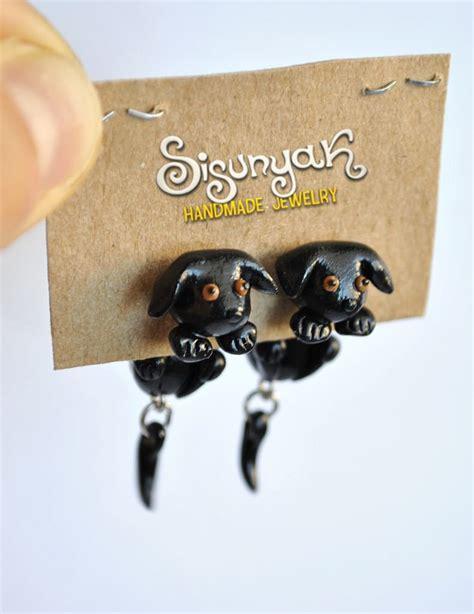 dogs with earrings sisunyak black earrings store powered by storenvy