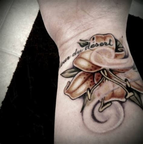 lily tattoo on wrist 34 awesome wrist flower tattoos