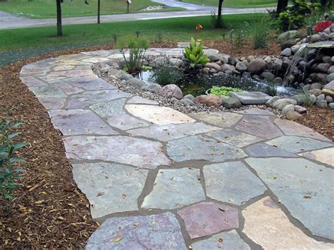 a flagstone walkway a sensible and nice driveway help meanwhile at the manse