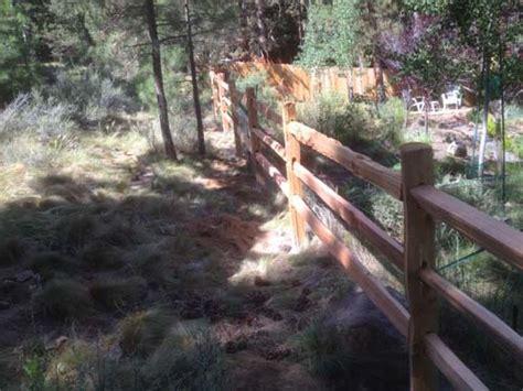 rough hewn livestock fencing bend fencing cedar chain