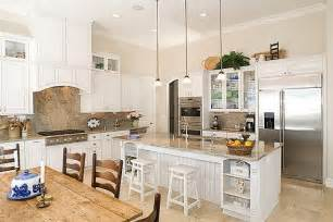 White cabinetry allows the color in decorative elements and the