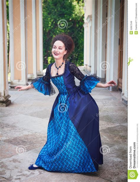 beautiful young woman  blue medieval dress  curtsey