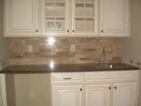 tiles backsplash herringbone backsplash kitchen painting maple cabinets white white vintage