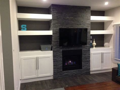 my diy fireplace with built in cabinets and floating