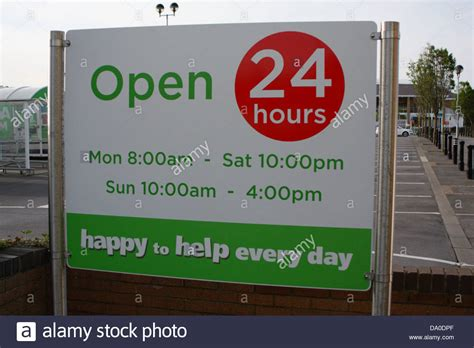 sign showing opening hours and times for asda super store