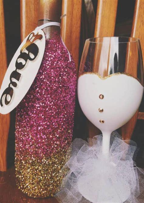 glittered wine bottles weddingplanningwonders