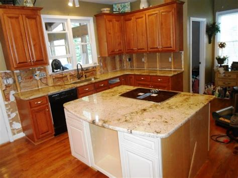 kitchen cabinets charlotte nc sienna beige granite on medium colored wood cabinets 4 9