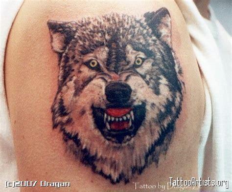 tattoo tribal vuk superb wolf face biceps tattoo tattoos book 65 000