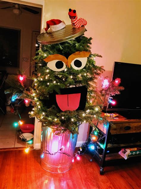 couple turns ugly christmas tree  oscarmas