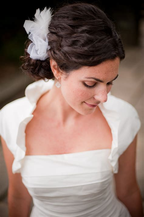 hairstyles for thick wavy hair updo romantic low bridal updo for thick curly hair onewed com