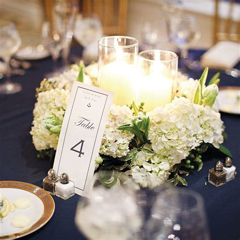 white hydrangea and candle centerpiece wedding flowers
