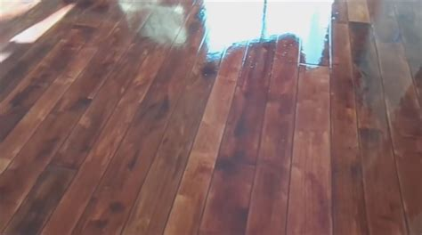 DIY Concrete Scored and Stained to Look Like Wood Floor