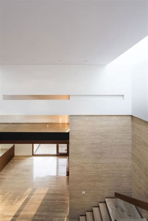 a sleek modern home with indian sensibilities and an a sleek modern house with indian sensibilities and an