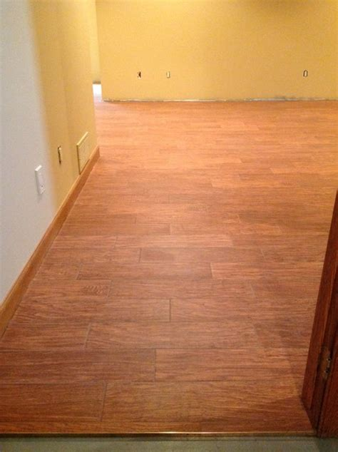 wood flooring basement porcelain floor tile simulated wood flooring basement other by artisan tile
