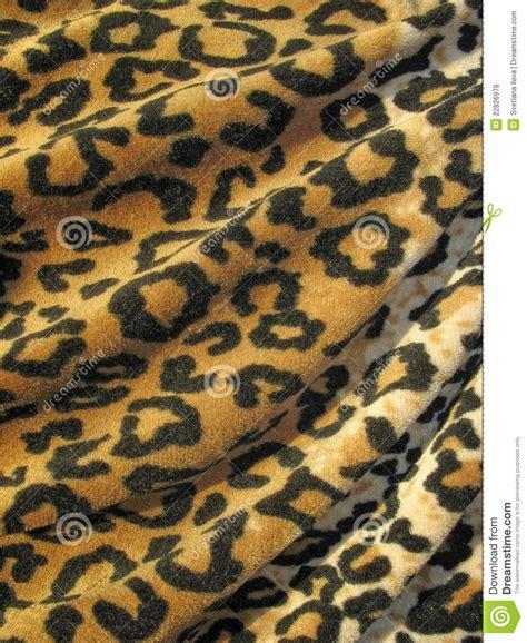draped fabric fleecy brown draped leopard skin fabric stock photo