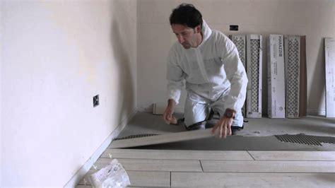 posatura piastrelle posa gres porcellanato effetto legno