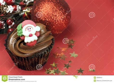 christmas chocolate cupcake  santa face  copy space stock photo image