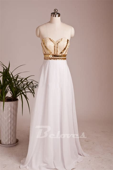 white sweetheart prom dress with beaded and gold sequins