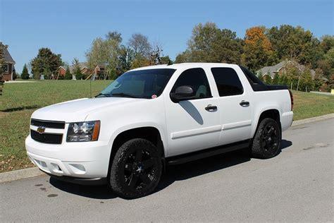 white truck black rims chevy avalanche white truck black rims always looks