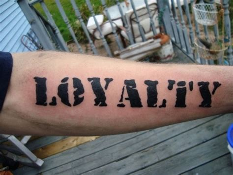 loyalty tattoo on forearm lettered black loyalty word on forearm