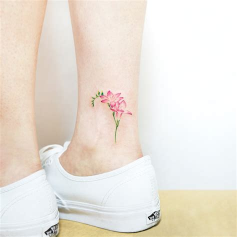 freesia flower tattoo designs 22 beautiful and delicate freesia designs tattooadore