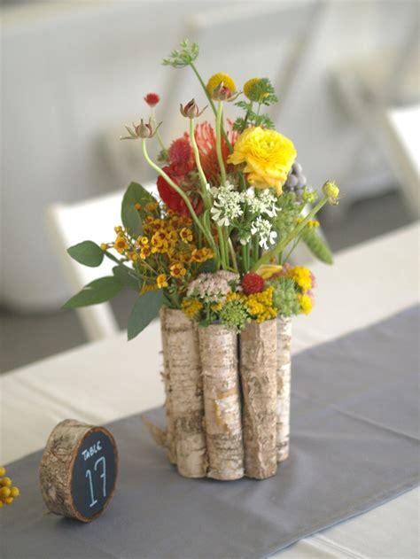 wildflower arrangements orange and yellow wildflower centerpiece orange and
