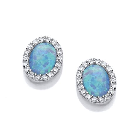 925 sterling silver oval synthetic opal stud earrings sterling silver blue opal classic oval studs by david deyong