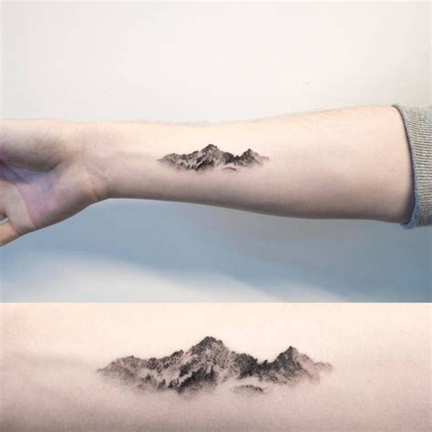 small inner arm tattoos mountain on the right inner forearm