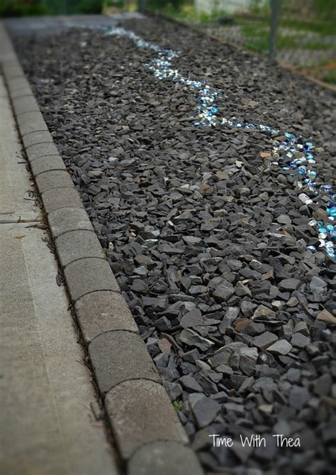 Garden Shale Rock How I Created A Garden Feature With Black Shale And Blue Glass Gems Hometalk