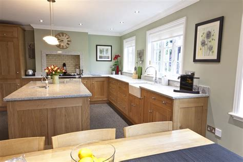 light oak cabinets in kitchen with paint colour like benjamin camouflage or november