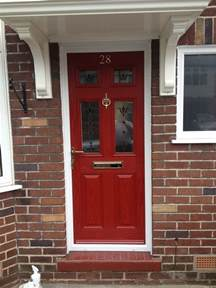 red front door and bold house exterior traba homes