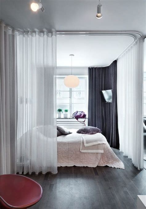 dividing a bedroom with curtains picture of sheer white curtains divide the bedroom area