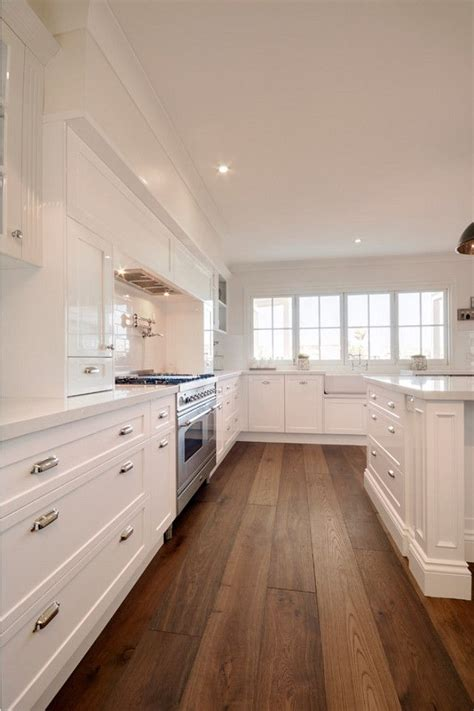1 wide wood floor kitchen kitchen with white cabinets and wide hardwood