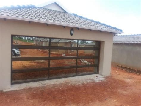 Aluminum And Glass Garage Doors Glass Garage Doors Aluminium Products Langenhovenpark Co Za