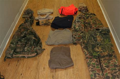 layout hunting gear dressing for hunts when the temperature is around 0