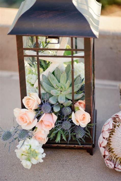 Lanterns Decorated With Flowers by 25 Best Ideas About Succulent Wedding Centerpieces On